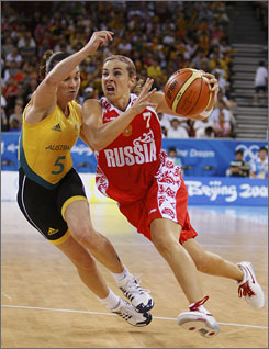 Becky Hammon, right, and Russia won first place in their pool after they roughed up  Tully Bevilaqua  and Australia.