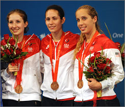 American fencers, from left, Becca Ward, Sada Jacobson and Mariel Zagunis won bronze in the team sabre competition but also finished 1-2-3 in individual competition with Zagunis earning gold, Jacobson the silver and Ward the bronze.