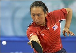 American Gao Jun plays a shot against South Korea during the bronze medal playoff on Saturday. Gao, who is in her third Olympics as an American after playing for her native China in 1992, lost her doubles match with Huang Crystal Xi and her singles match.