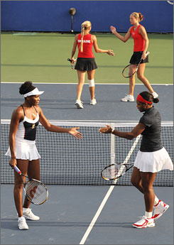 Serena, bottom right, and Venus Williams play against Alena, top right, and Kateryna Bondarenko from Ukraine during the women's doubles semi-final tennis match.