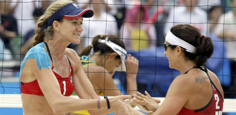 Misty May-Treanor, left, and Kerri Walsh of the USA celebrate defeating Larissa Franca and Ana Paula Conelly of Brazil in their women's beach volleyball quarterfinal match.