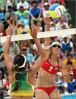 """Brazil's Ana Paula Conelly tries to block the smash from Misty May-Treanor of the USA. """"I don't think we ever got into a great rhythm. We had some ups and downs,"""" admits May-Treanor, after the match. """"But Kerri did a great job at the net defensively."""""""