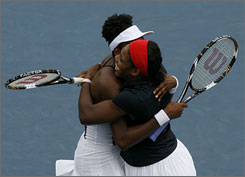 Serena, right, and Venus Williams celebrate after winning their women's doubles final tennis match.