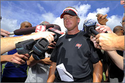 """Bucs coach Jon Gruden says the team even films its meetings. """"We might sign a player the seventh or eighth day of camp,"""" he said. """"During lunch time, a guy might go into a room and watch a meeting."""""""