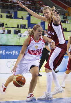 After playing in Russia's professional league and not qualifying for the U.S. women's Olympic team, Becky Hammon, left, attained citizenship as an avenue to Beijing.