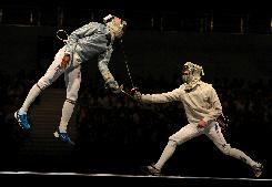 Keeth Smart of the USA, left, helped the U.S. men team advance to the finals. Nicolas Lopez, right, led the French men's team to a sabre gold medal. The USA won silver.