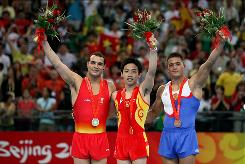 The medal winners in men's floor exercises: From left, Gervasio Deferr of Spain won the silver medal, Zou Kai of China won the gold medal, and Anton Golotsutskov of Russia won the bronze.