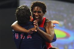 Randi Miller of the United States celebrates winning the bronze medal in the 138.75-pound class of women's wrestling.