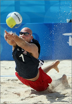Philip Dalhausser lunges for the return during the United States' victory over Germany in the quarterfinals of beach volleyball.