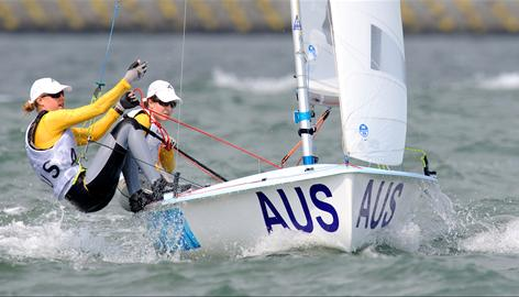 Sailors Elise Rechichi and Tessa Parkinson of Australia turn a mark during the 470 women's class event.