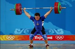 Andrei Aramnau of Belarus sets a world record with his lift of 200 kg.
