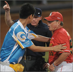 Chinese manager Jim Lefebvre had some words for the Dutch umpire after his catcher, Yang Yang, took a hard hit from Nate Schierholtz as he scored in the sixth inning. A Chinese administrator tried to restrain Lefebvre, who was ejected from the rough-and-tumble game.
