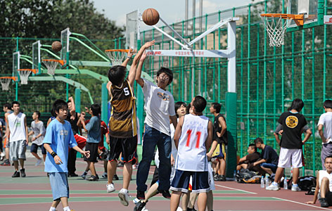 Chinese youths play pickup basketball games at a local Beijing park. Basketball's popularity is booming in China, where an estimated 600,000 new courts are being constructed.