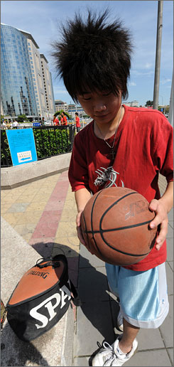 Jia Xiao Long, 19, is one of many Chinese youths who play basketball at Dong Dan Athletics Center in Beijing. He even has a special bag he uses to transport his ball.
