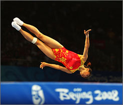 China's He Wenna bounces her way to victory in the women's trampoline competition.