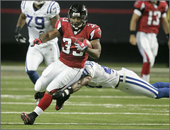 """""""He's got home run speed as well as he's got a very low center of gravity,"""" Falcons coach Mike Smith says of free-agent signee Michael Turner. """"All you are seeing is shoulder pads and knees. There's not a lot of body surface to tackle him."""""""