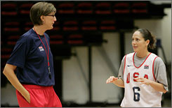 American basketball coach Anne Donovan talks strategy with Sue Bird, right, during a recent practice.