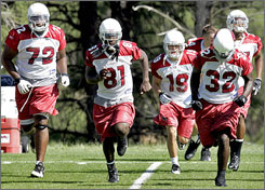 "Cardinals wide receiver Lance Long (19) has been compared to Patriots receiver Wes Welker and former Jets wideout Wayne Chrebet for his gritty style. ""I feel I've got a long ways to go,"" Long said. ""I just go out there and try to treat every day like it's my last day, my last opportunity to try and make it."""