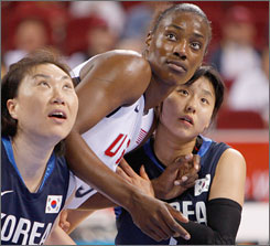 Korea's Sunmin Jin, left and Younah Choi try their best to defend against Sylvia Fowles, who burned them for 26 points and 14 rebounds on Tuesday.