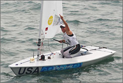 USA's Anna Tunnicliffe celebrates overall victory in the Laser Radial class event following the medal race. Tunnicliffe won total points in 10 races.