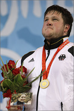 German gold medalist  Matthias Steiner catapulted himself from third to first with a 258-kg clean and jerk lift. He carried a photo of his late wife, Susann, to the medal stand.