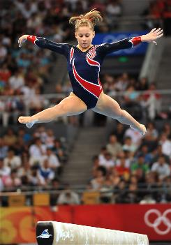 USA gymnast Shawn Johnson concentrates on her performance on the balance beam.