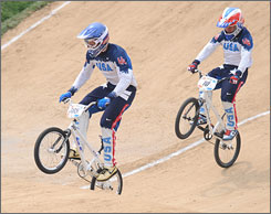 Americans Mike Day, left, and Donny Robinson, put their wheelie prowess to good use while covering the course at Beijing's Laoshan Bicycle Moto Cross Venue.