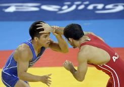Henry Cejudo, in blue, of the USA squares off against Azerbaijan's Namig Sevdimov in their freestyle wrestling semifinal match. Cejudo won to move on to the gold-medal match.