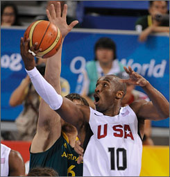 Kobe Bryant moves past Australia's Andrew Bogut en route to the USA's 116-85 quarterfinal victory. He and his teammates will face defending champion Argentina or Greece for a shot at the gold medal.
