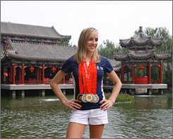 Nastia Liukin poses in front of Prince Yun Palace in Beijing before Wednesday's press conference with the USA's gymnastics medalists.