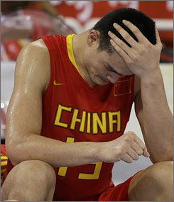 Disappointment sinks in for Yao Ming after China's 94-68 quarterfinal loss to Lithuania on Wednesday.