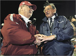 Florida State coach Bobby Bowden can tell Penn State's Joe Paterno, right, that he leads him by one win in the race for most coaching victories.