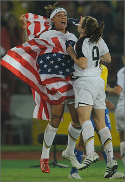 Americans Natasha Kai, left, and Heather O'Reilly celebrate the team's gold medal soccer win, 1-0, over Brazil in Beijing on Thursday night.
