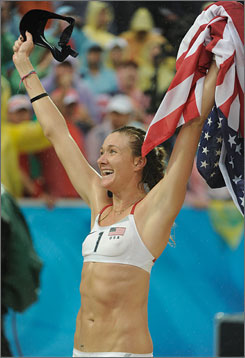 Kerri Walsh celebrates winning her second-straight beach volleyball gold medal while holding an American flag on Thursday in Beijing. Walsh and her partner Misty May-Treanor won in Athens.