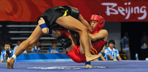 American Maximillion Chen, bottom, is thrown to the mat by Korea's Soon-Myung at a Wushu tournament in Beijing Thursday.