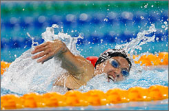 USA's Sheila Taormina swims her 200 meter heat in the modern pentathlon event at the Fencing Hall Friday. She stood in 32nd place after gaining 1,376 points in swimming, but ultimately worked her way up to 19th place overall.