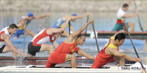 China's Yang Wenjun, center, and Meng Guanliang, right, won the men's 500-meter (546.8-yard) final in a minute and 41 seconds.
