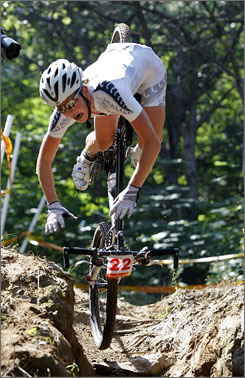 Rosara Joseph of New Zealand loses her balance on a descent during the women's mountain bike race, which was won by Sabine Spitz of Germany.