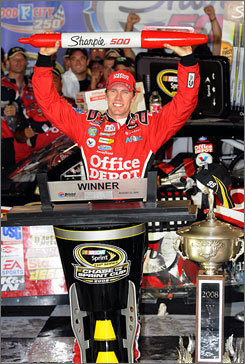 Carl Edwards celebrates his win in the NASCAR Sprint Cup Sharpie 500 at Bristol Motor Speedway. Edwards took the lead with 30 laps to go in the race.