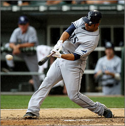 The Tampa Bay Rays' Carlos Pena hits a two-run single in the 8th inning against the Chicago White Sox to give his team the lead. The Rays beat the White Sox 5-3.