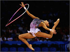 Evgeniya Kanaeva of Russia competes in the Individual All-Around final held at the University of Science and Technology Beijing Gymnasium.