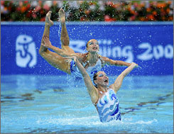 Russia's eight-woman squad of swimmers won the team free routine in synchronized swimming, Saturday. Members Anastasia Ermakova and Anastasia Davydova have already won the duet gold.
