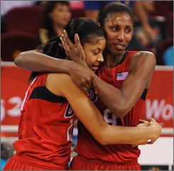 Lisa Leslie, right, and teammate Candace Parker embrace as the final seconds expire on Leslie's Olympic playing days.