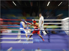 A zoomed-out picture shows China's Zhang Zhilei, right as he battles Italy's Roberto Cammarelle during their super heavyweight final boxing match in Beijing on Sunday.