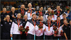 The USA's men's volleyball team celebrates after being presented with gold medals. The Americans defeated Brazil in four sets in the final in Beijing on Sunday. 
