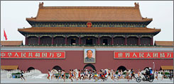 Women's marathon runners go past Tiananmen Square where a media-rights group asked runners in Sunday's men's marathon to turn their back on the portrait of Mao Zedong. No one did.