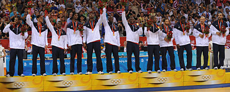 The USA men's basketball team waves to fans after receiving their gold medals in Beijing on Sunday.