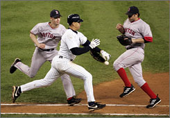 In a key play in the 2004 American League Championship Series, the New York Yankees' Alex Rodriguez was called out for interference after knocking the ball out of the glove of Boston Red Sox pitcher Bronson Arroyo, left, as first baseman Doug Mientkiewicz looks on.