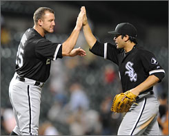 The Chicago White Sox's Jim Thome, left, and Carlos Quentin celebrate Thome's 535th home run, putting him in sole possession of 15th place on the career home-run list.