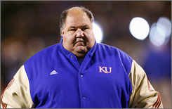 Kansas fans wanting to get a glimpse of coach Mark Mangino's squad during practice are going to have a tough go at it after the school plants 100 pine trees obstructing two practice fields.